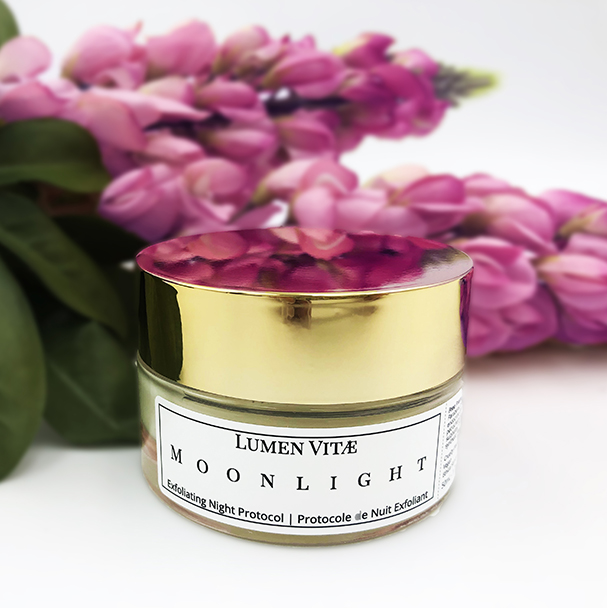 about us Moonlight exfoliating night protocol with pink flowers and green leaves laying