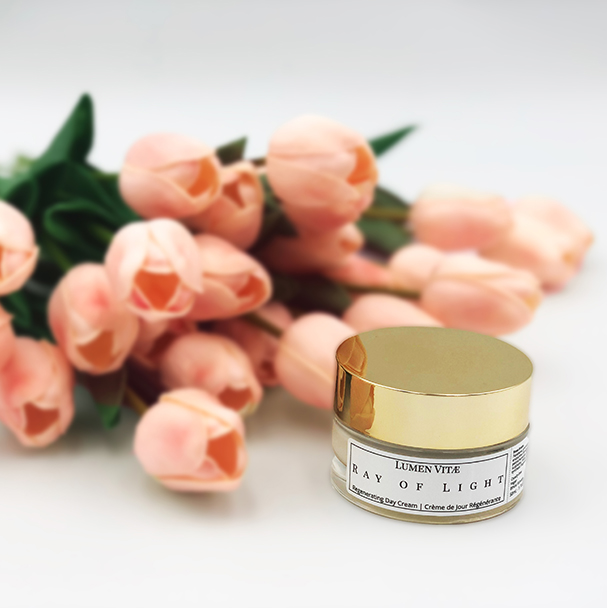 Ray of light regenerating day cream with pink tulips laying